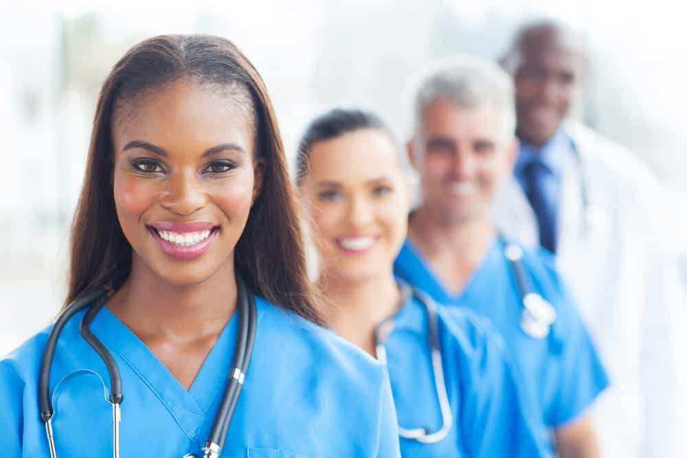 Happy people working in healthcare