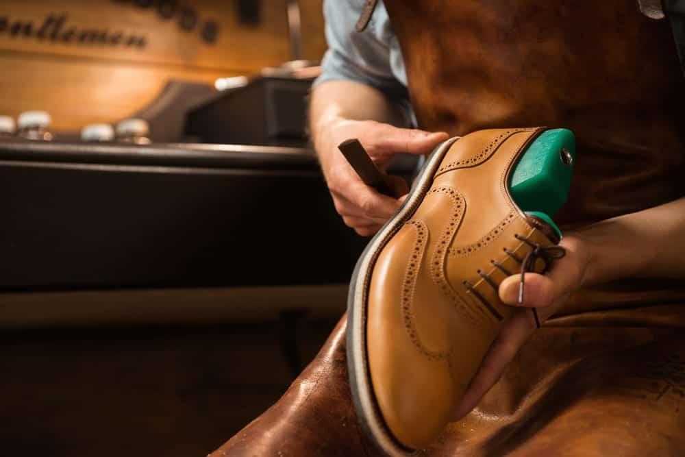 Shoemaker finishing a leather men's shoe.