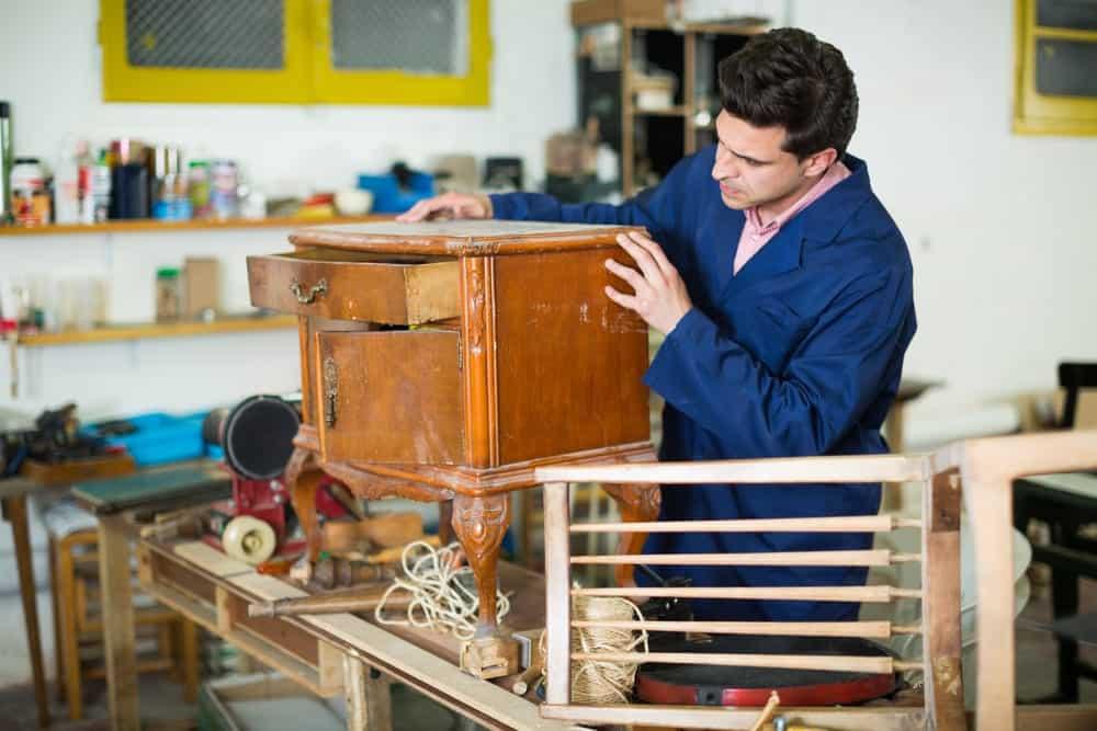 Man restoring old furniture for donation