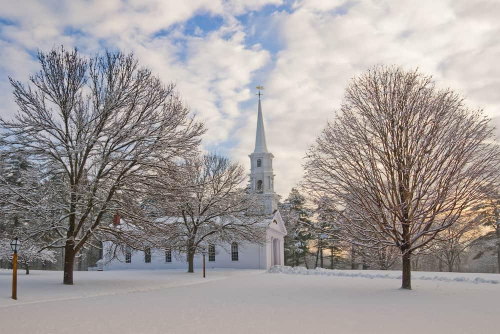 Winter snow around a church in Sudbury, MA